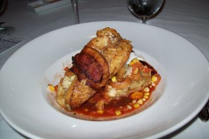 Bacon wrapped walleye with corn & tomato, sweet potato praline bread pudding and Carolina BBQ sauce