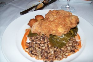 Buttermilk fried chicken with tomato & onion stewed collards, black eye peas, corn & hot pepper hushpuppies
